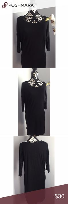 Dolman Tunic Dress 3/4 sleeve, loose fit tunic dress in Black. Features an elastic off the shoulder with choker. 95% Rayon, 6% Spandex Boutique Dresses