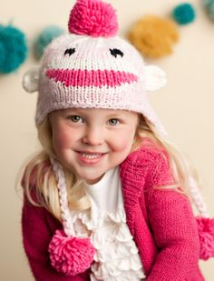 This adorable hat has pompoms and panache. Darling for warmth or just cute photos. If in doubt, size up! Hand knit from 100% super soft acrylic. Sizing Guide: X-Small (0-3 months) Small (3-18 months)