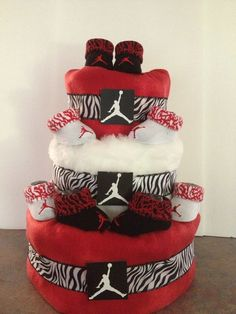 This is a neutral themes pamper/ Diaper cake. It is made with receiving blankets, size 1 diaper and Michael Jordan Babies booties. Also available in other colors and themes. Please contact for pricing and availability.
