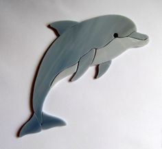 This Dolphin consists of 10 individual pieces of glass.it is not assembled in any way. Stained Glass Ornaments, Stained Glass Suncatchers, Stained Glass Designs, Stained Glass Projects, Fused Glass Art, Glass Wall Art, Stained Glass Patterns, Stained Glass Art, Mosaic Animals