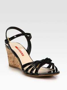 e664a577cb6d2 Prada Leather Bow Cork Wedge Sandals in Black (nero-black)
