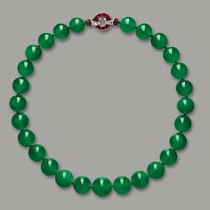 A Cartier jadeite bead, ruby and diamond necklace owned by Woolworth heiress Barbara Hutton (1912 – 1979) sold for more than $27.4 million at Sotheby's Hong Kong Magnificent Jewels and Jadeite Auction, held Monday. The sale set world auction records for a jadeite jewel and for a Cartier jewel, the auction house said. It sold for more than double its estimate of $12.8 million.