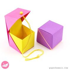Hinged Origami Box - Cube Version Tutorial via Here are the instructions on how to fold a cube shaped origami gift box with a hinged lid using two sheets of paper. No glue is required for this hinged origami box. Origami Design, Diy Origami, Gato Origami, Origami Simple, Origami Bowl, Origami Cube, Origami Paper Folding, Paper Crafts Origami, Useful Origami