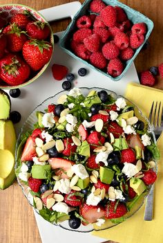 Triple-Berry Summer Salad includes three types of plump berries, creamy avocado, tangy goat cheese, and crunchy almonds. This salad is unbelievable!   iowagirleats.com