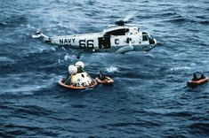 Apollo 11 crew boarding a recovery helicopter after a successful splashdown on July 24, 1969.