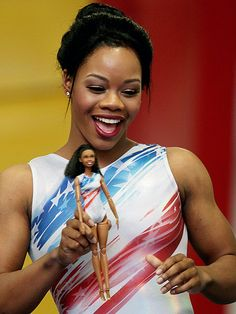 """Want a Gabby Douglas Barbie? The gymnast debuted her """"Shero"""" doll right before she nabbed a spot on the US Olympic gymnastic's team for the second time. Gymnastics Team, Olympic Gymnastics, Olympic Team, Olympic Games, Women's Gymnastics, Artistic Gymnastics, Gymnastics History, Gymnastics Quotes, Gymnastics Posters"""