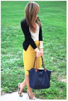 simple white polka dot top and black cardigan. chic yellow skirt. And her necklace and shoes really puts her outfit tother.