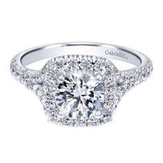 14k white gold 1.27cttw halo diamond engagement ring with .62ct I/SI2 round diamond center. This ring features .65cttw of G/SI round diamonds accenting the center round diamond with a vintage style cu