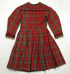 Red Plaid Girl's Dress, circa 1870 | This style of dress with a pleated front (often in red plaid like this) was popular during the 1860s. 1870 is on the later end of this style. #Victorian #1860s #1870s