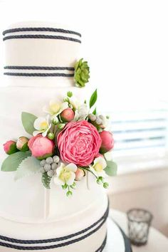 Damn, do those flowers look good with classy pinstripes! (Modern White and Black Wedding cake with Fresh Pink and Cream Flowers)