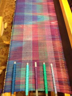 Choosing weft colors that work best with a handdyed warp.