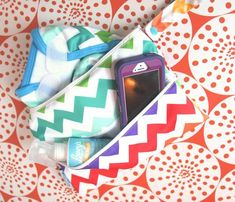 Chevron & Skittles - Our improved triple-compartment (yes, triple!) Multi-use Wallet is a serious must-have! Generous full-sized pockets are individually lined with PUL making it easy to clean, and they fit a TON.