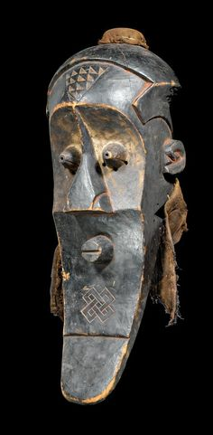 Mask from the Bushoong Kete people of DR Congo   Wood and natural fiber