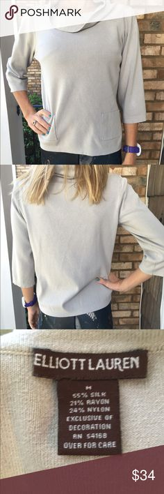 Gray silk pullover with pockets NWOT. Brand new never worn silk blend turtleneck pullover by the designer Elliott Lauren. This top feels amazing on your skin! It's literally silky smooth, and even has two front pockets. This is a great fall basic for a steal of a deal! Length is 23 inches and armpit to armpit measures 19 inches across. Thanks for looking.💕 Elliott Lauren Sweaters Cowl & Turtlenecks