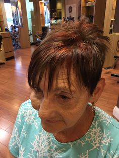 Tobacco brown hair color lot with red copper highlights to emphasize her fun short and texturized hairstyle