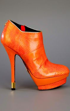 Cesare Paciotti. Sharp, sharp, sharp...though I'd lower the heel a bit, and slice the platform or even better - do away w/ it! ~BB