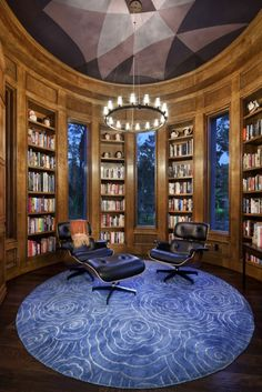 Circular home library with a couple of Charles Eames-Lounge Chairs and Ottoman by Aaron Leitz Photography #books #library #libri #biblioteca #livres #bibliotheque #interiordesign - More wonders at www.francescocatalano.it