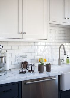 : The Kitchn: Ryan's Kitchen Tour : Apartment Therapy I like the white subway tiles with the marble counters...