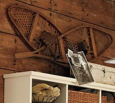 PB Found Wood Snowshoes #potterybarn Mine are larger, but another way to decorate with them (without the photo) ...