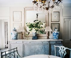 blue and white ginger jars on a buffet table. also love the gold and crystal chandelier
