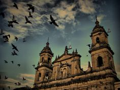 This kind of poetic image, is the Catedral Primada de Bogotá (Cathedral of Bogota) and it's in front of the Plaza de Bolivar (Bolivar Square).