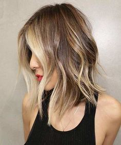 Shoulder length grazing waves to layers and swept back wet looks