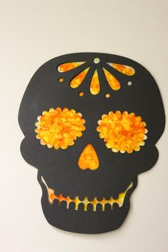 Making Day of the Dead skulls using a vegetable peeler, crayons, wax paper, and an iron. Great fine motor activity for all ages.