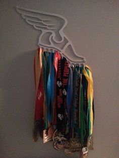Display to hold all your running or triathlon medals, made from brushed aluminum, hand formed. 11 hooks has been used to hold over 20 medals.