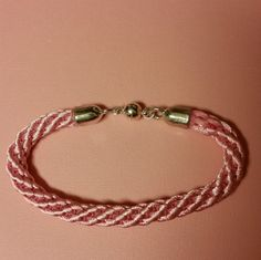 Check out this item in my Etsy shop https://www.etsy.com/listing/256208010/pink-kumihimo-bracelet