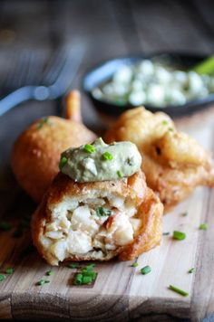 Blue cheese lobster beignets with spicy avocado cream.