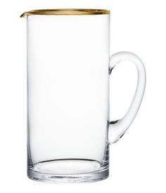 Jug in clear glass with a handle and gold-coloured rim #HMHome
