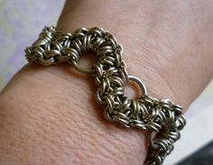This is a handmade chainmaille bracelet using the Shenandoah chainmail weave. The chainmaille bracelet is made using nickel silver, and has a pretty flower Gypsy Bracelet, Chainmaille Bracelet, Gypsy Jewelry, Handmade Jewelry, Unique Jewelry, Jewelry Ideas, Handmade Gifts, Jewelry Design, Designer Jewelry