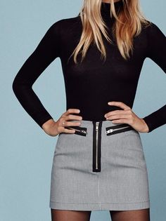 Tights on, tights off. This is a mini length skirt with a center front, exposed zipper and zip details.