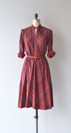 Vintage 1970s soft cotton blend dress with elastic waist, long sleeves, full skirt, collarless and red belt. ✂-----Measurements fits like:
