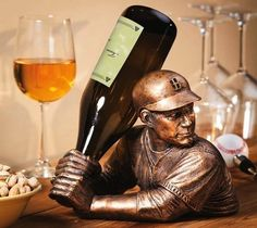 The Bam VinoTM captures your love of baseball and wine. Sculpted to look like a baseball player getting ready to hit a homerun, the bottle fits top down into the player's hands to form the bat. The Bam VinoTM is sure to be an instant conversation piece and an addition to your everyday decor.