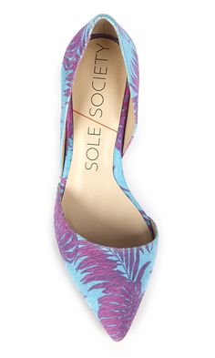 Suede mid heel d'Orsay pump in a blue raspberry tropical print. Perfect for office to happy hour.