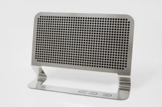 Flat Boombox by Hannes Harms. Perforated acid-etched stainless steel with a flat speaker component.