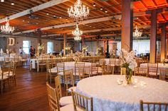 Industrial meets Elegance at this white and gold wedding at Brazos Hall. We provided our white splendor rosette linens and gold chiavari chairs! Event Planner: Pearl Events Austin | Reception Venue: Brazos Hall | Ceremony Venue: St. Mary's | Caterer: Whole Foods Market Austin Culinary Center and Catering | Flowers: Megan Martinez | Cake: Sweet Treets Bakery & Cafe | Band: The Drywater Band | Photographer: Jake Holt Photography |