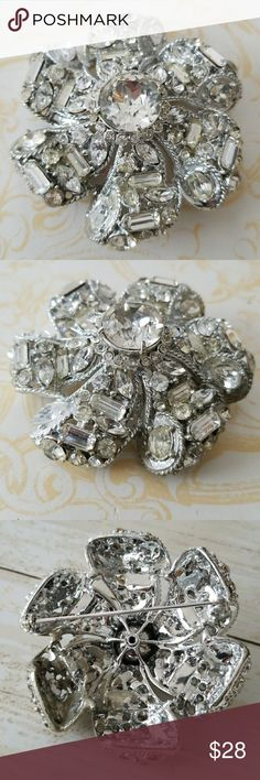 Vintage Huge Rhinestone crystal Flower brooch pin Gorgeous Vintage Rhinestone flower with a multitude of rhinestone shapes and sizes: rounds,  Marquis, oval, oblong  Very good Vintage condition  No stones missing but a few might not be original to the piece. Does not alter the look or beauty of the piece💖 Huge large center stone Pin back is secure Gorgeous statement piece! Vintage Jewelry Brooches