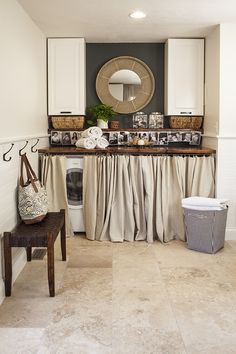 Super cute laundry nook. I love the wood countertop over the washer/dryer...the dark accent wall with the mirror and the pictures! | House*Tweaking