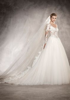 I highly doubt Meghan will were tulle when she marries Harry. She wore tulle in her TV wedding and I'm sure she'll want to draw a clear distinction between reality and fantasy on her Wedding Day. But you've gotta admit, this dress is beautiful!