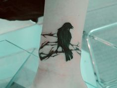 Japanese watercolor style crow tattoo.