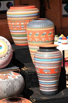 "Native American pottery on display at a Santa Fe, New Mexico, market. ""The Fine Art Photography of Frank Romeo."""