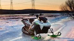 Quick off the mark electric snowmobile quietly cuts through deep powder