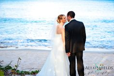 Beautiful bride and groom on the beach
