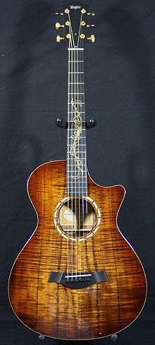 Taylor KOA GC 12-FRET Limited Edition. I love my cedar/rosewood 12 fret, but this one's the bomb too!