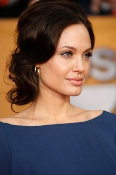 Angelina Jolie.....This makeup is actually very pretty. However I think it would have looked better on her if the lips had a tad more color.