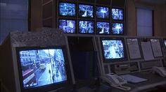 security-surveillance-monitors-in-control-room-at-police-station-video-id1320-66 (640×360)