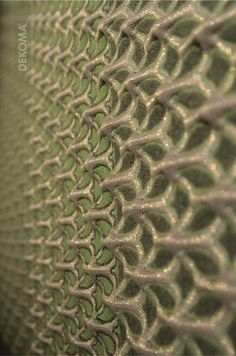 A part of an exhibit from the Architexture collection designed by Aleksandra Gaca, a well-known European designer. The focus is put on advantages of 3D woven fabrics which Ms Gaca is explores. Thanks to ribbed textures, Architexture panels absorb sound waves more efficiently than flat textiles. #3Dtextiles