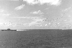 USS_Enterprise_(CV-6)_under_attack_at_Battle_of_Leyte_Gulf_1944 - WAR HISTORY ONLINE Uss San Jacinto, Uss Enterprise Cv 6, Uss Intrepid, Navy Aircraft Carrier, Leyte, Imperial Japanese Navy, Us Navy Ships, History Online, Army Veteran